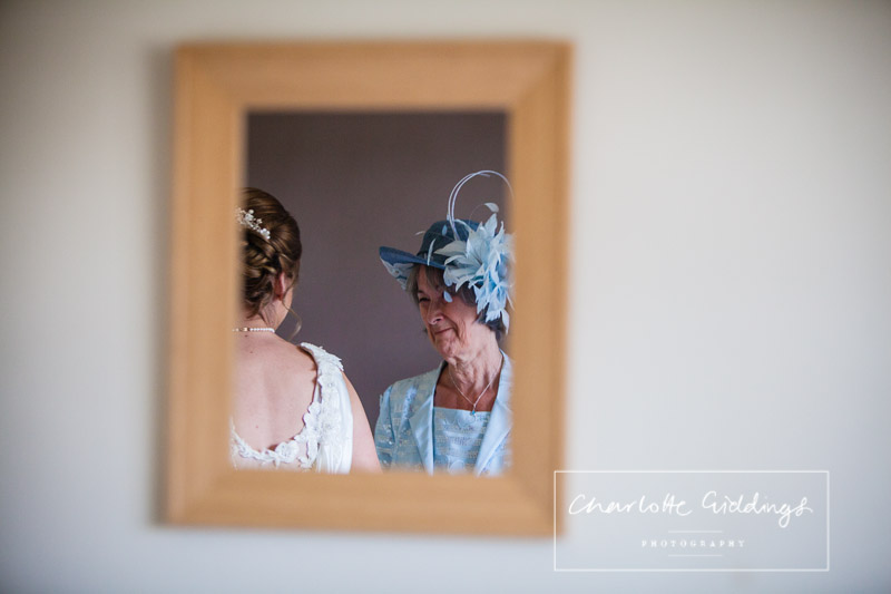 mother of the bride seeing her daughter on her wedding day