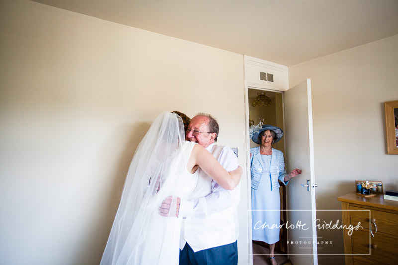 father of the bride cuddling the bride