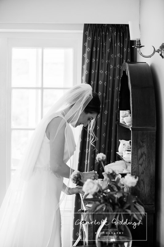 bride having a moment before leaving for soulton hall
