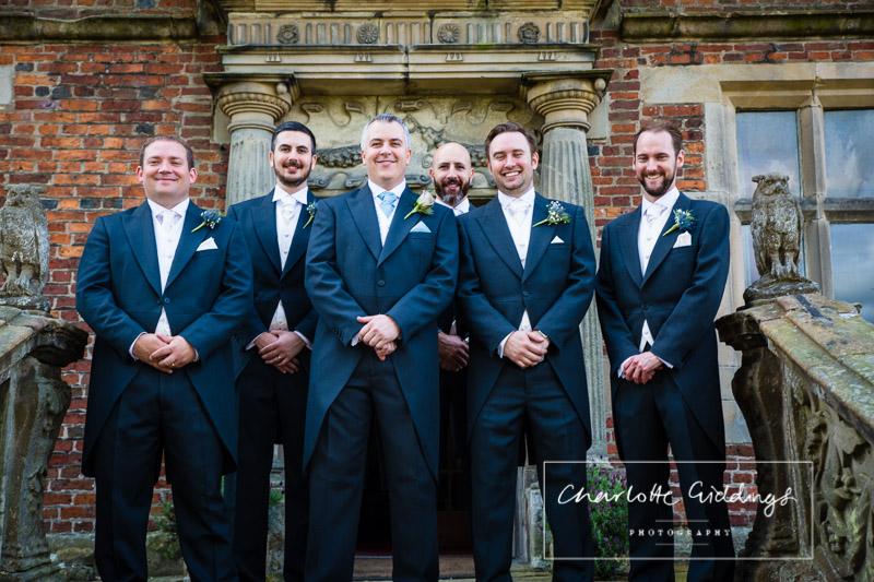 groom and groomsmen outside soulton hall