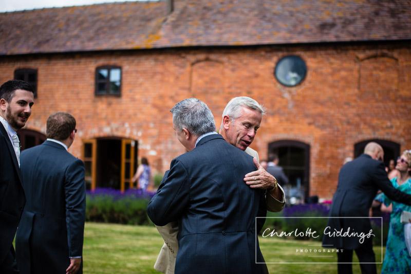 groom greeting guests at soulton hall