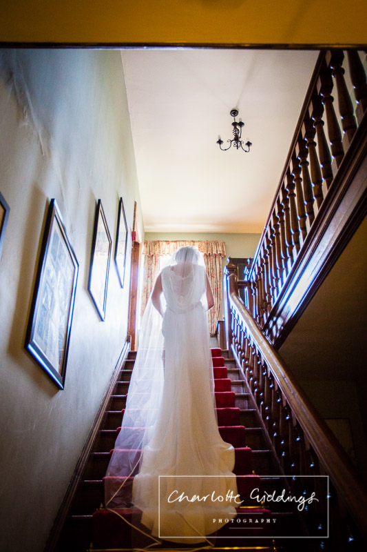 bride on the main stairs in soulton hall
