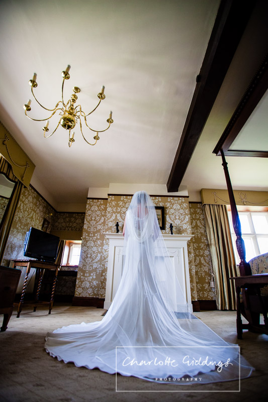 back of wedding dress in wedding suite at soulton hall