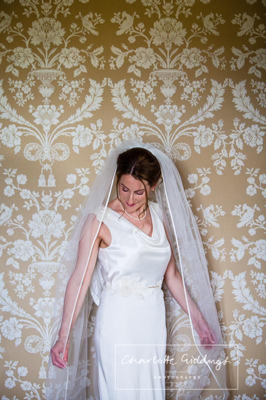 portrait of bride in wedding suite at soulton hall