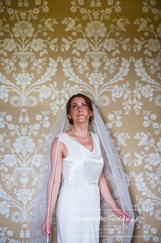 bride in bedroom at soulton hall
