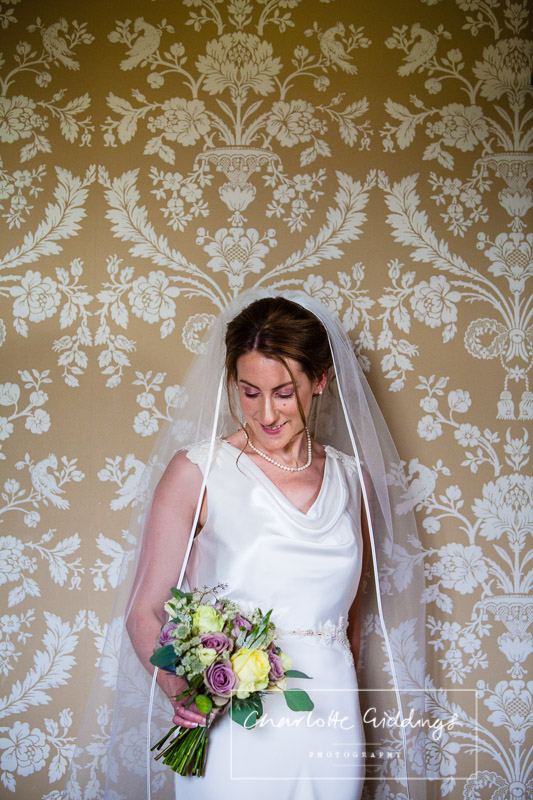 natural light photo of bride in room at soulton hall