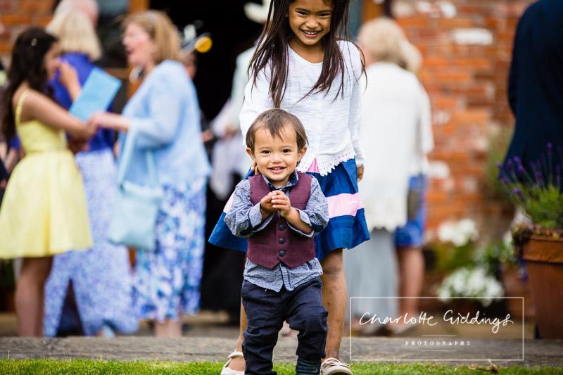 brother and sister having fun at wedding