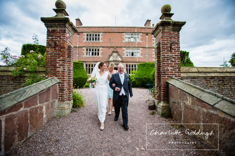 bride and father of the bride walking over to ceremony at soulton court