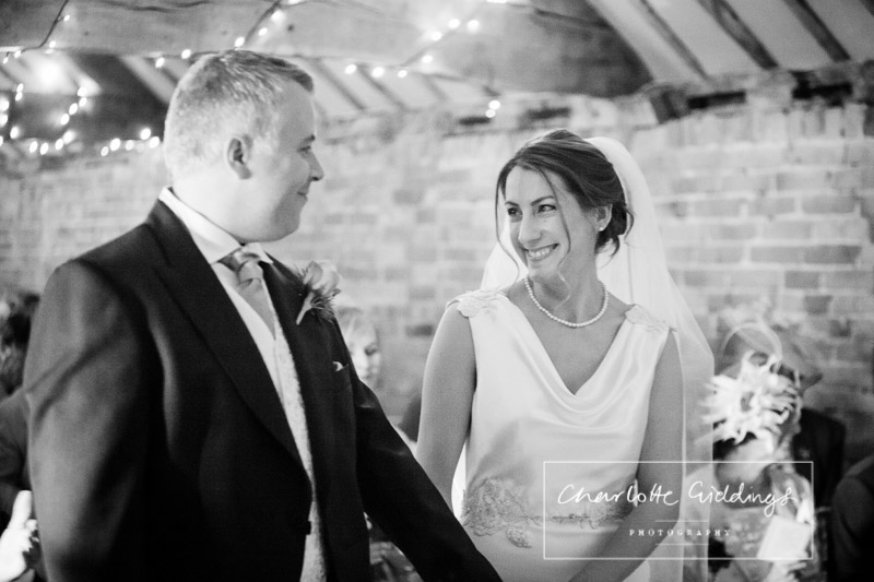 bride and groom glance in ceremony