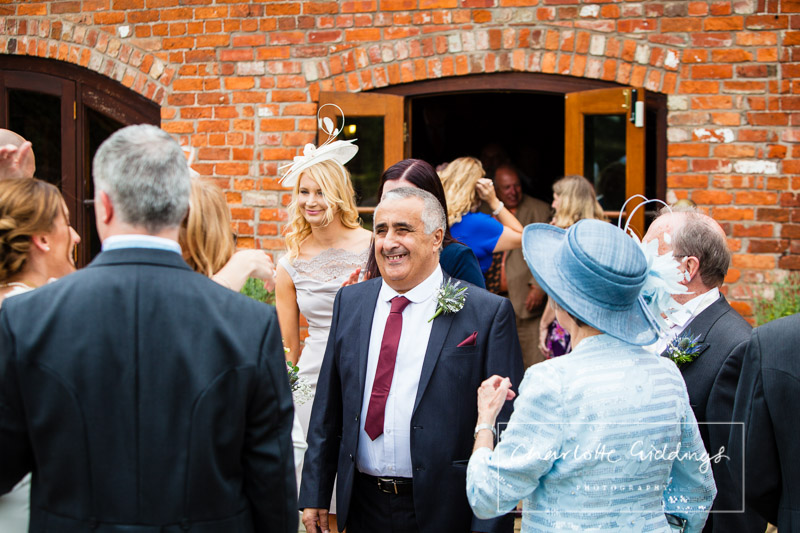 father of the groom greeting after ceremony