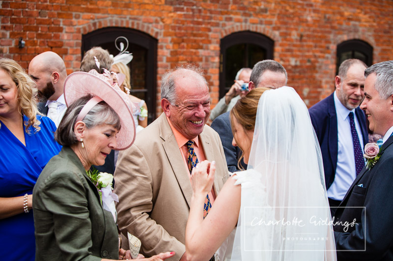 guest greeting bride after wedding ceremony