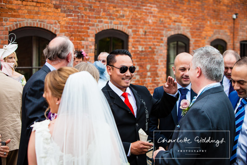 friend greeting guest after ceremony at soulton hall