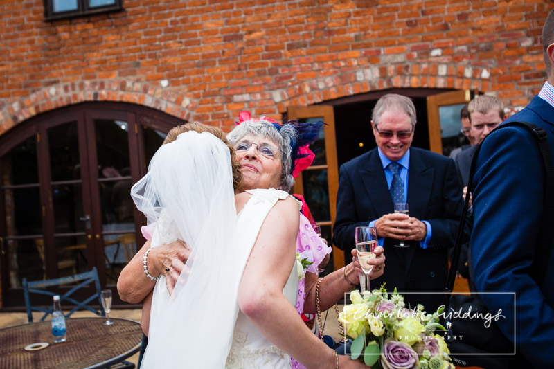 friend greeting bride after wedding ceremony shropshire
