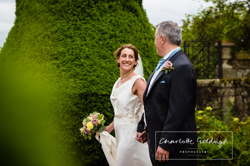 candid photo of bride with groom soulton hall