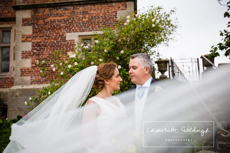 veil shot of bride and groom at soulton hall
