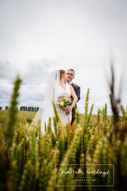 bride and groom in wheat field at soulton hall