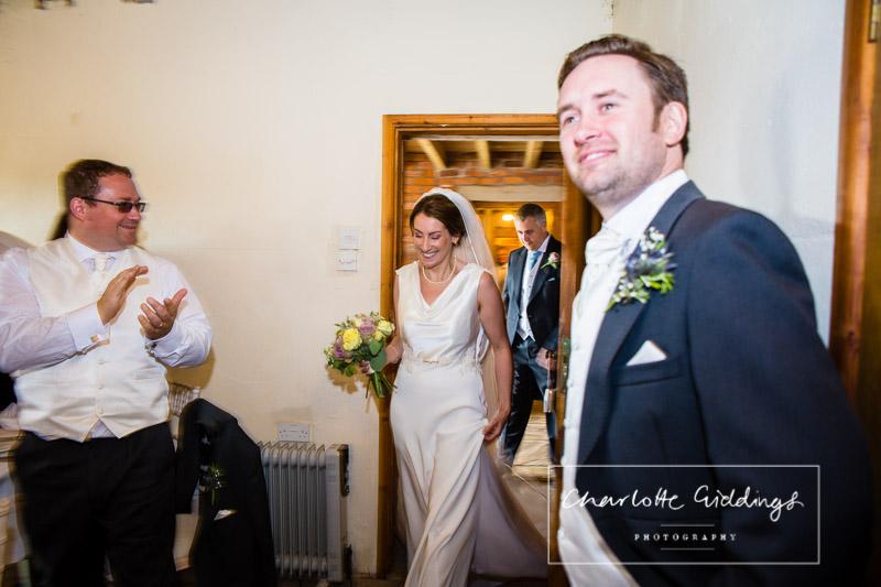 bride and groom entering soulton court wedding breakfast