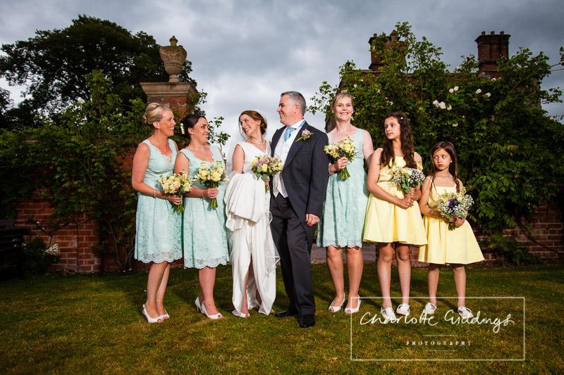 bride, groom and bridemaids portrait