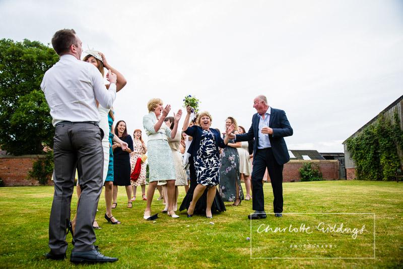 soulton hall wedding photographer action shot catching bouquet