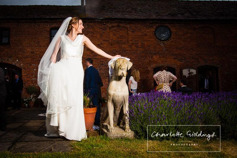 bride portrait with dog statue soulton hall