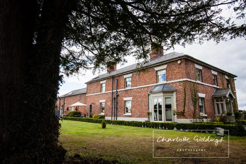 exterior shot of willington lodge, shropshire wedding photographer