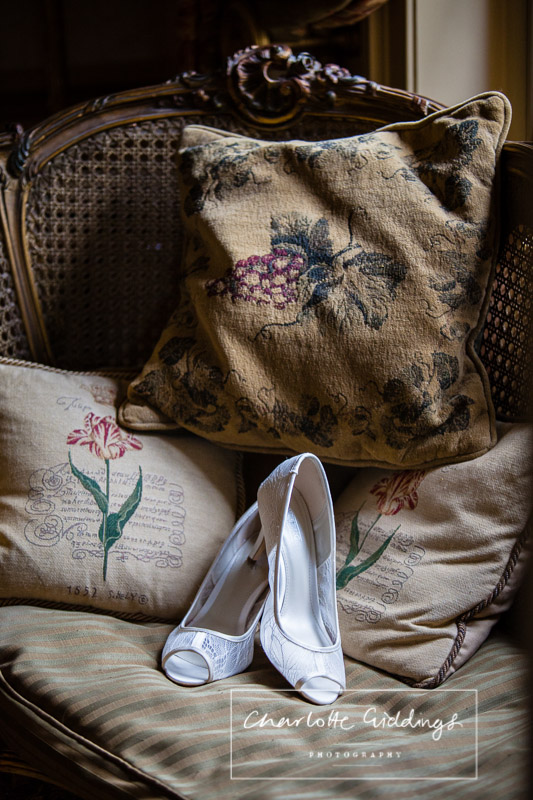 lace peep toe wedding shoes in natural light on chair at willingto hall