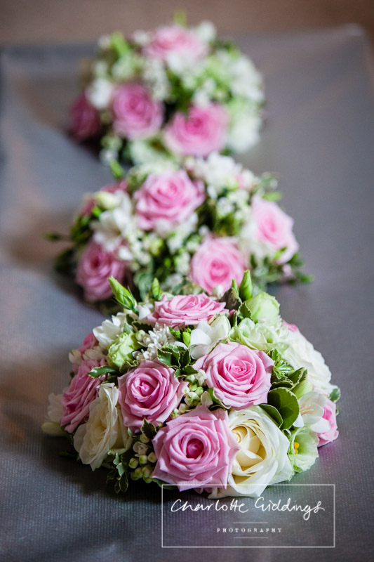 pink and cream rose bouquets by flower divas shropshire wedding photographer