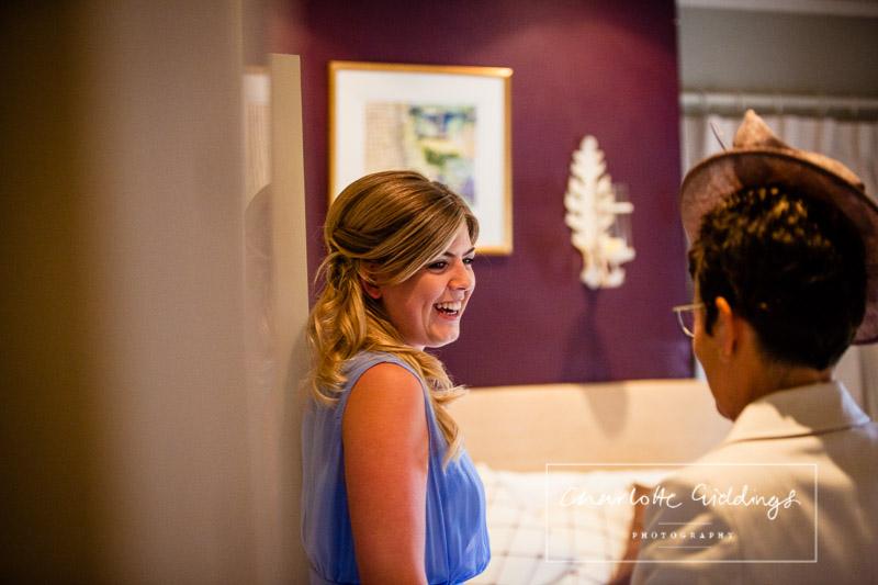 bridesmaid laughing at relative during bridal preparations