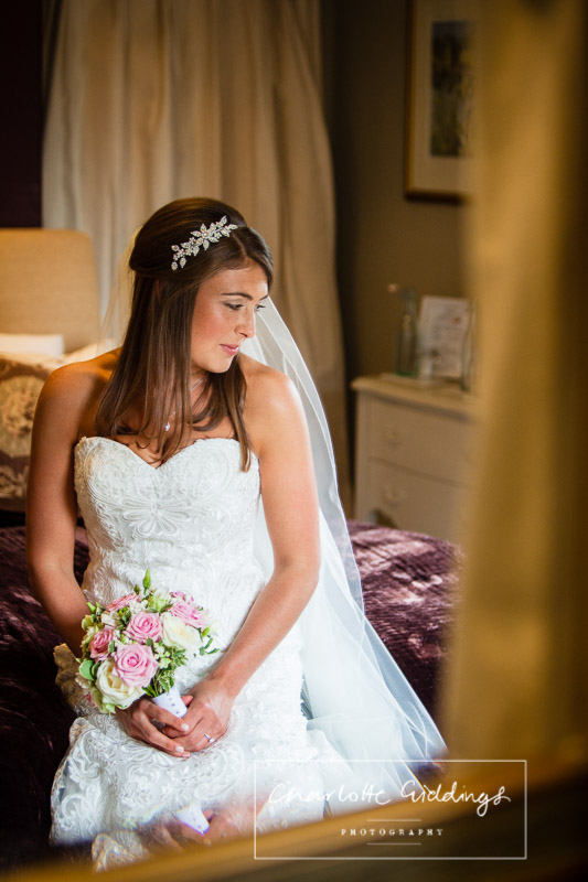 portrait of brides reflection in the mirror at willington lodge shropshire wedding photographer