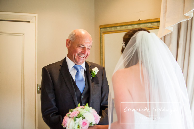 father of the bride seeing his daughter for the first time in her wedding dress charlotte giddings photography