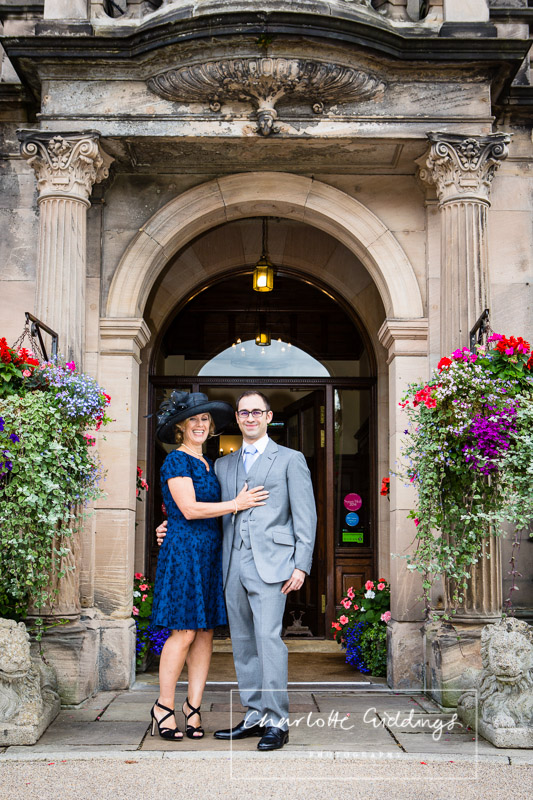full lentgth doorway photo with the groom and mother of the groom - looking very proud charlotte giddings photography