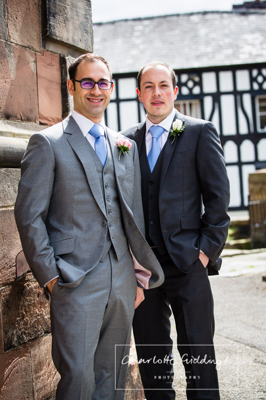 groom and best man portrait outside st. alkmunds church whitchurch shropshire