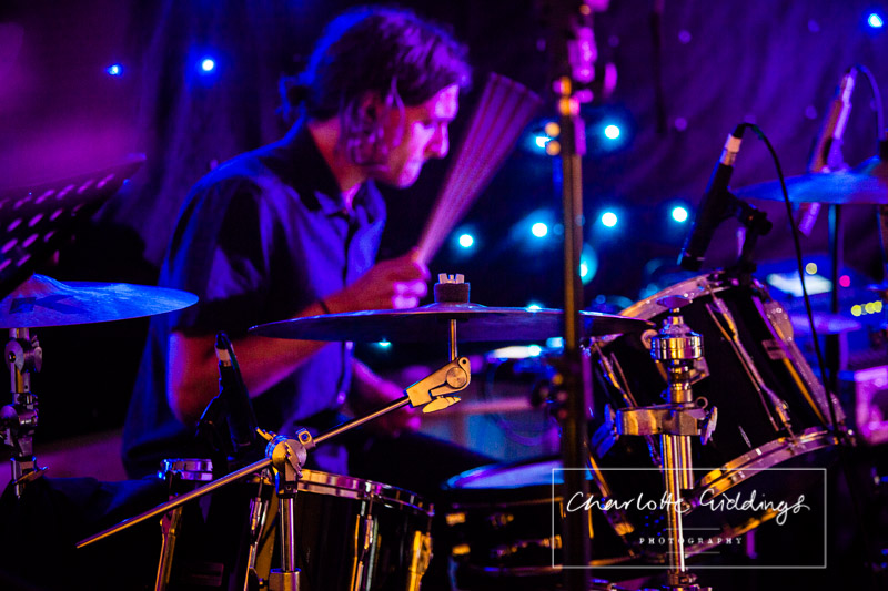 drummer action shot at combermere abbey summer wedding - charlotte giddings photography