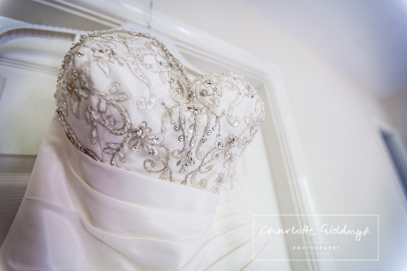 brides wedding dress close up of details and beading