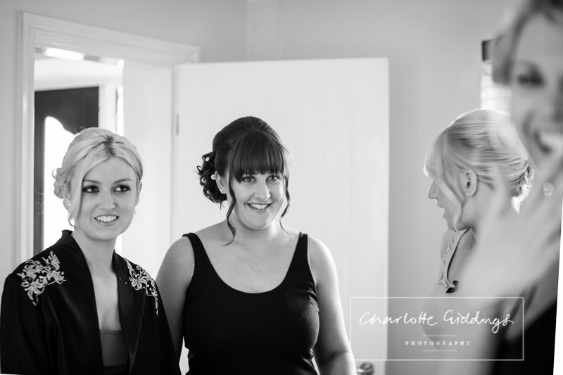 maid of honour looking at the bride happily