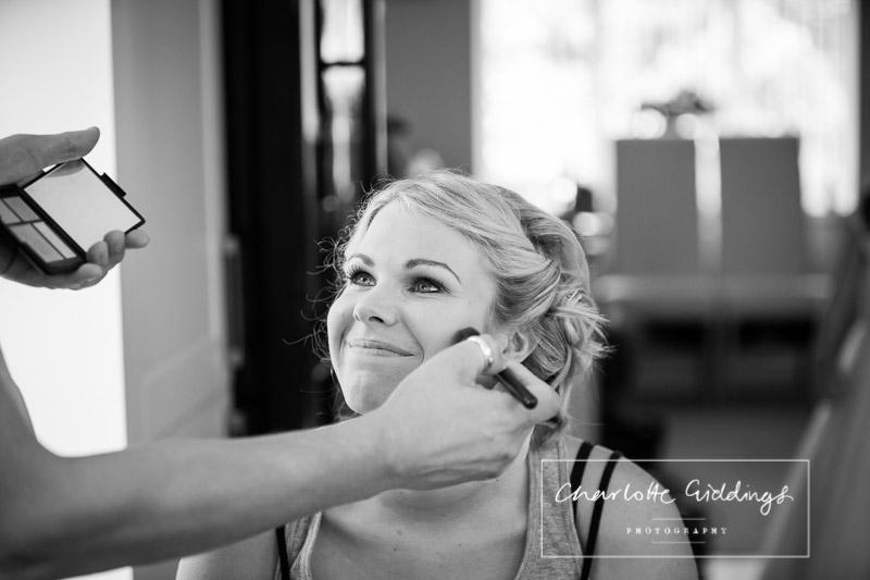 bride having her makeup done looking radiant