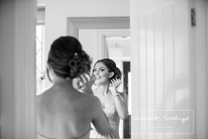bridesmaids refelection in the mirror