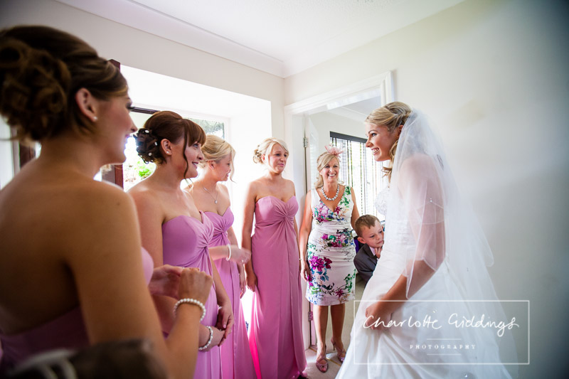 bride showing the bridesmaids how she looks