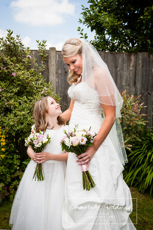 bride and flower girl looking at each other