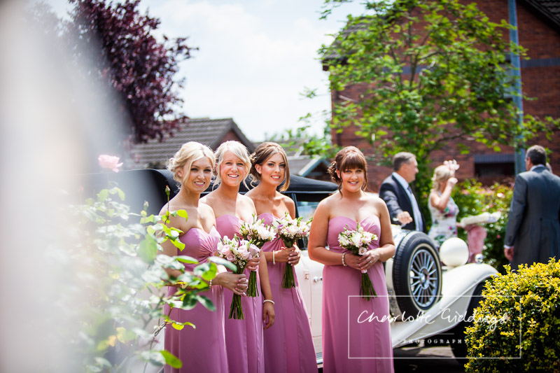 bridesmaids waiting for bride by car
