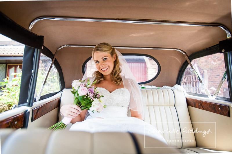 radiant bride ready in wedding car