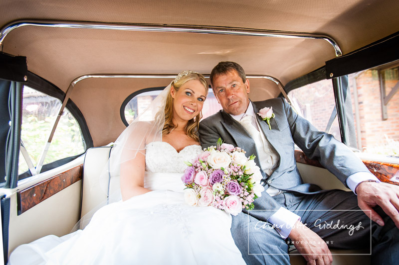 bride and father of the bride in the wedding car