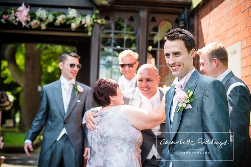 very happy groom waiting at st. mary's church, wistaton