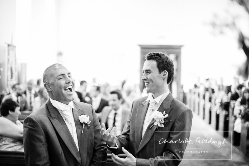 groom and bestman banter waiting at the alter