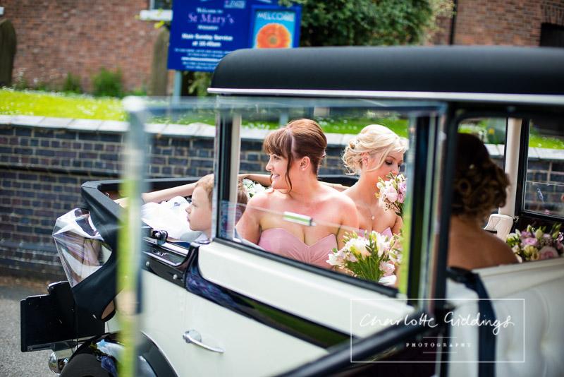 bridesmaids arriving in wedding car