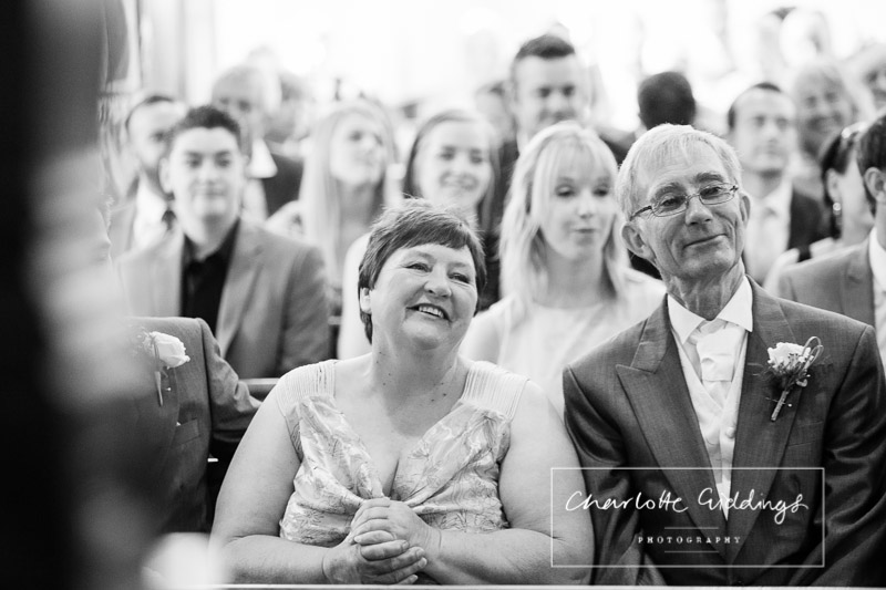 adoring photo of mother and father of the groom