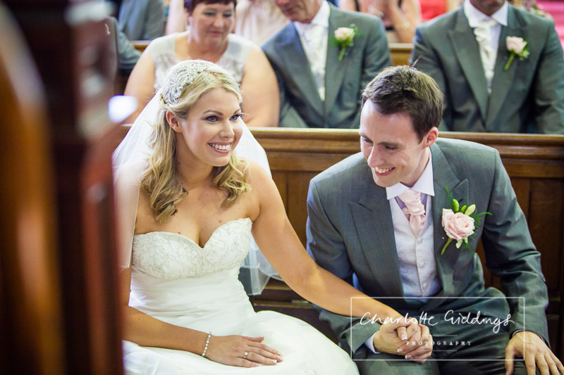 bride and groom at the front of church laughing