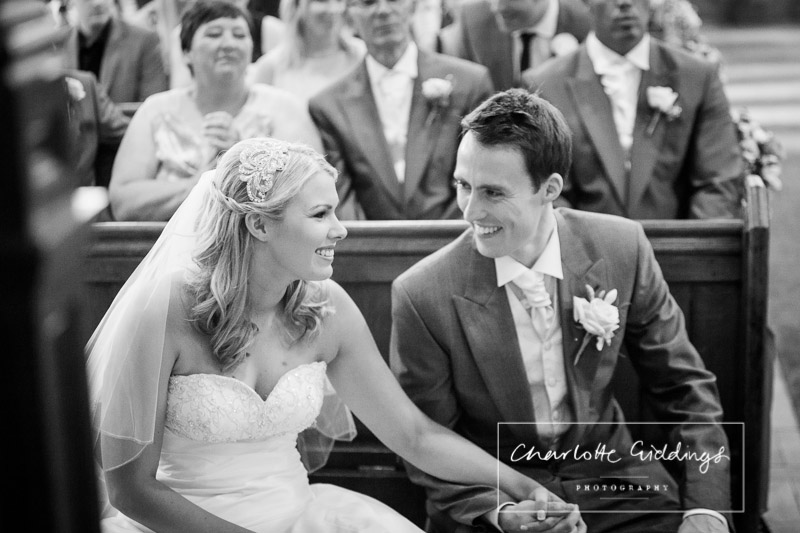 black and white bride and groom laughing