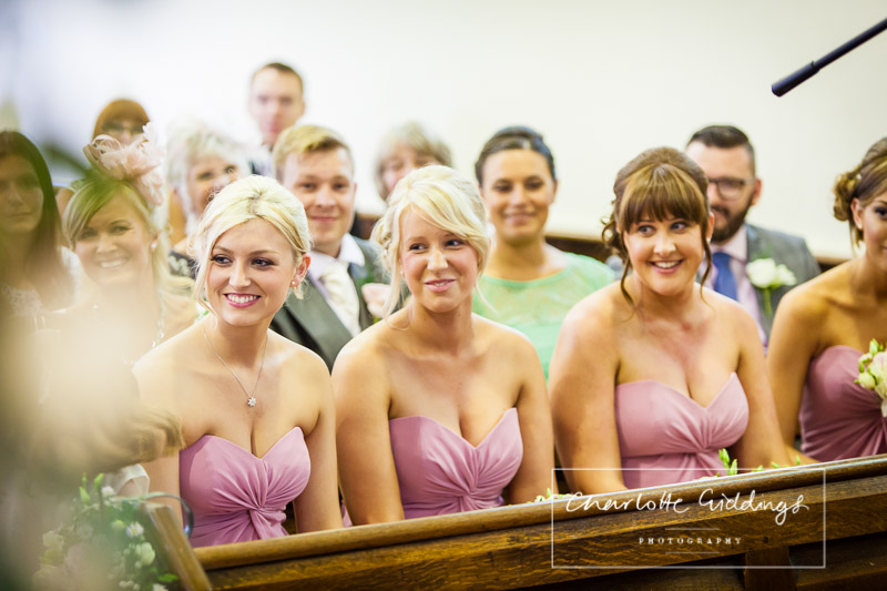 all the bridesmaids watching at st. mary's church, wistaton