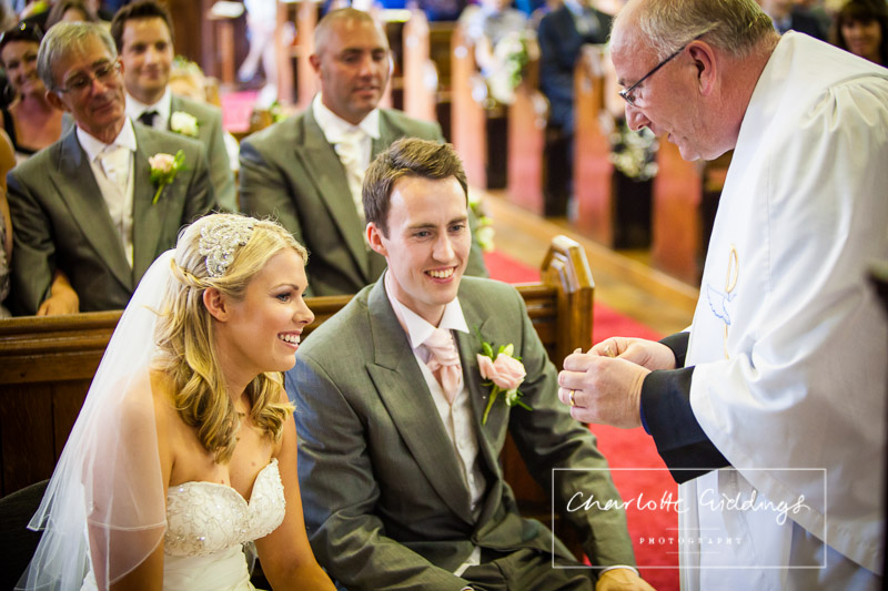 reverend interacting with the bride and groom